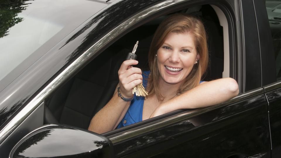 Teenage girl happy to be driving and finally getting her drivers license