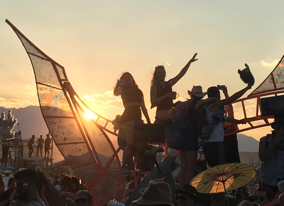 Sunset dance party at Burning Man 2018, in Black Rock City, Nevada.