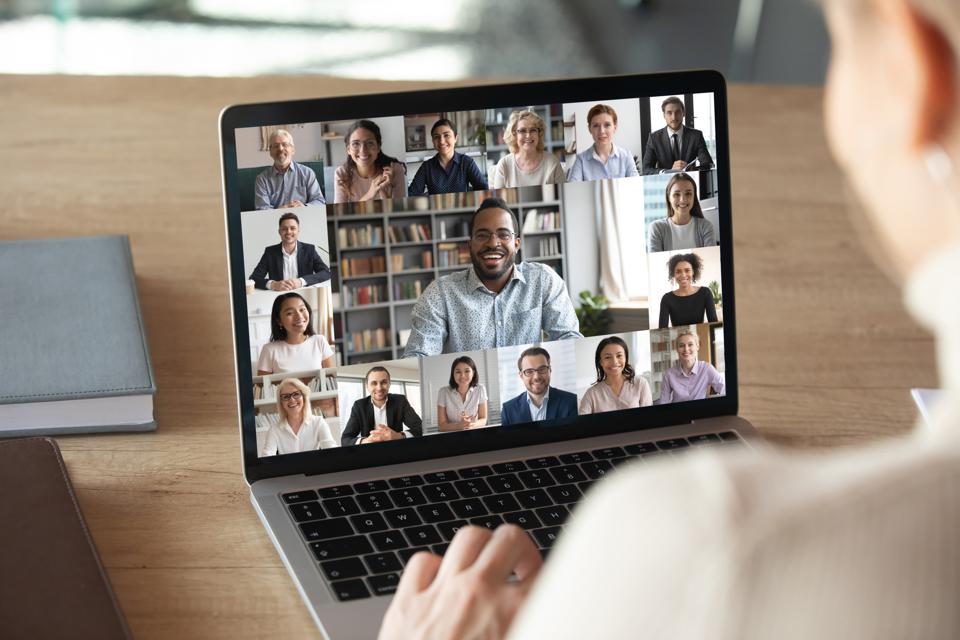 Female employee talk on video call with colleagues