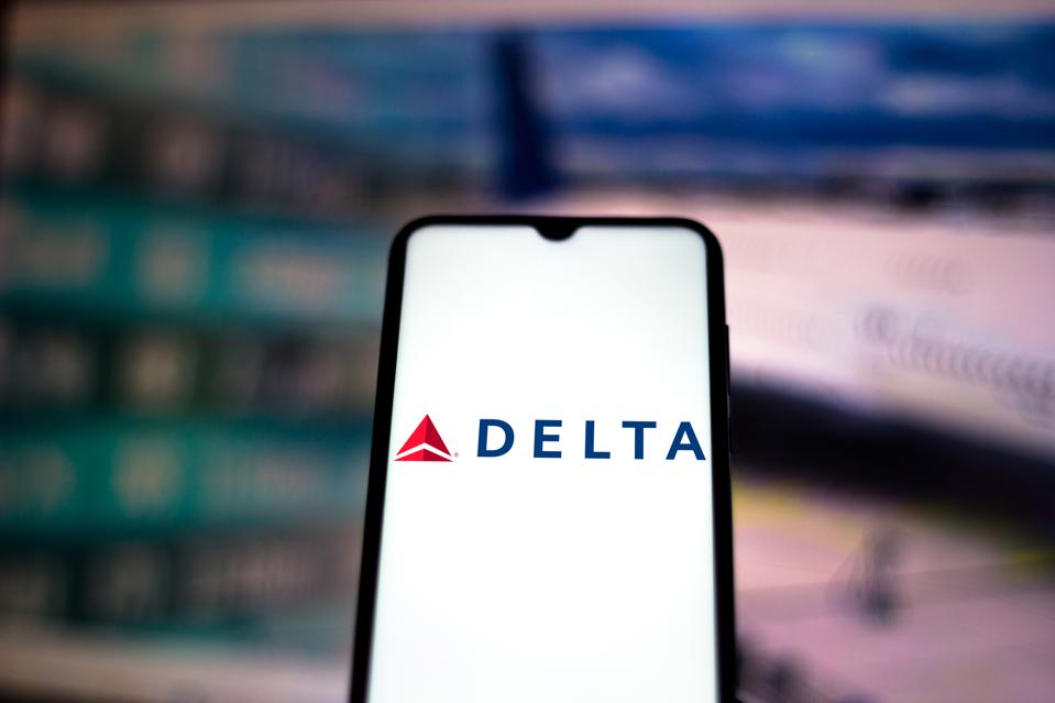 In this photo illustration the Delta Airlines logo seen...