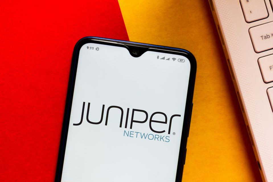In this photo illustration the Juniper Networks logo seen...