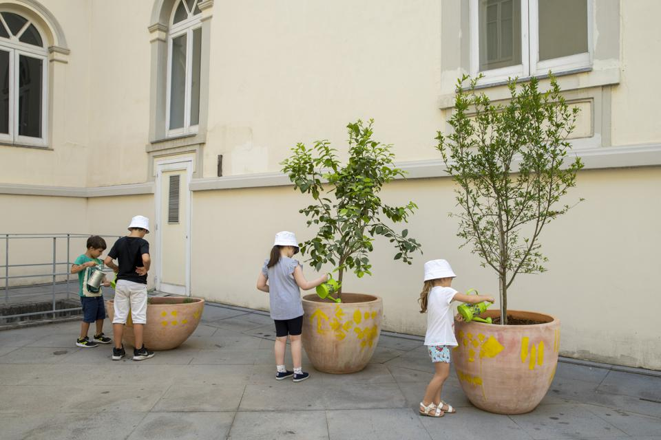 Children participating in Planting and Plant Love, a series of workshops connected to the installation.