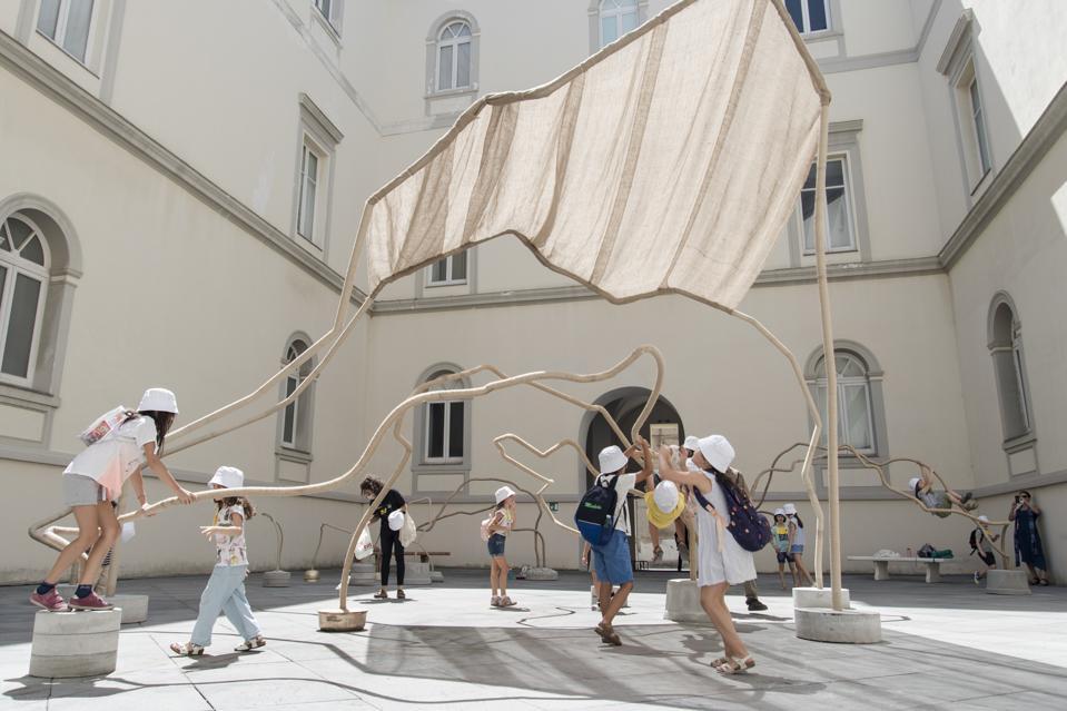 A view of children playing in Temitayo Ogunbiyi's installation