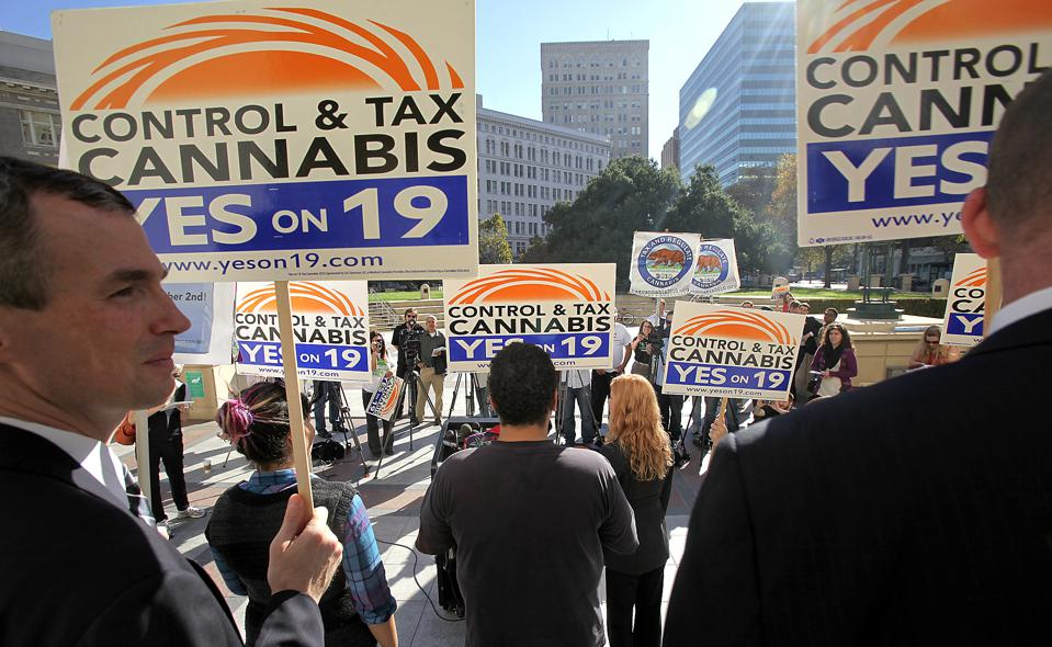 Supporters of Prop 19, a marijuana legalization initiative, rally on the steps of Oakland City hall