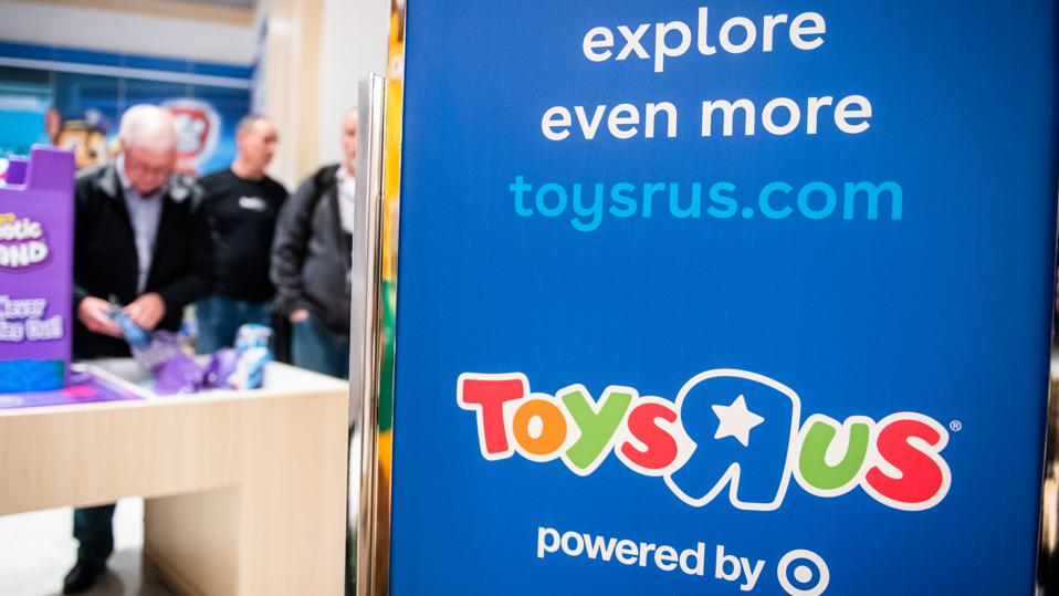 Toys R Us Inc. and Target Corp. logos are displayed on a sign at the company's new store in Paramus, New Jersey, U.S., on Tuesday, Nov. 26, 2019.
