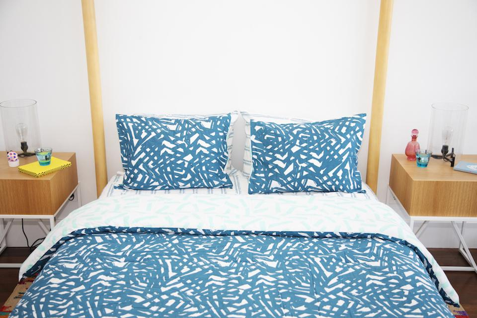 Lane bedding collection, blue and white pattern on a four poster wooden bed