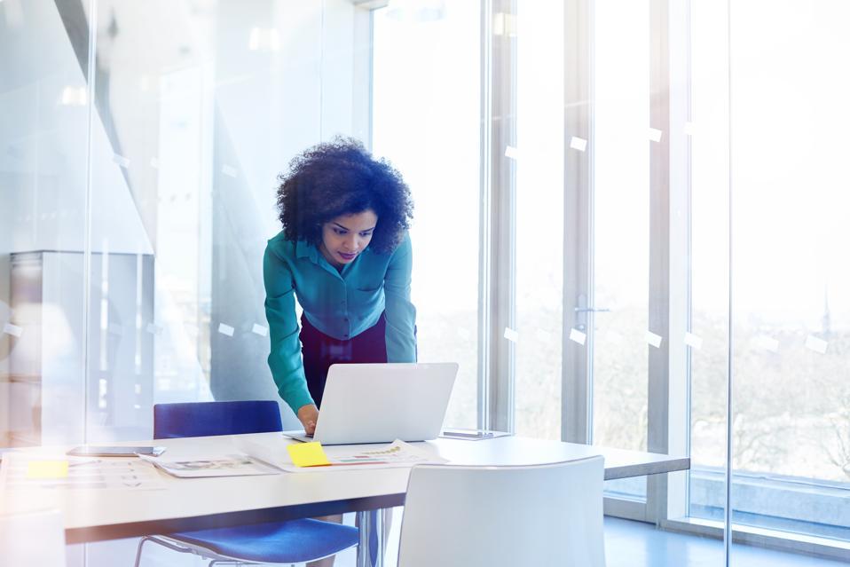 Woman working in modern glass office