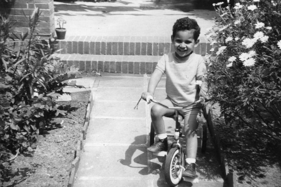 A black and white picture of 3-year-old Jordi Artal on his tricycle.