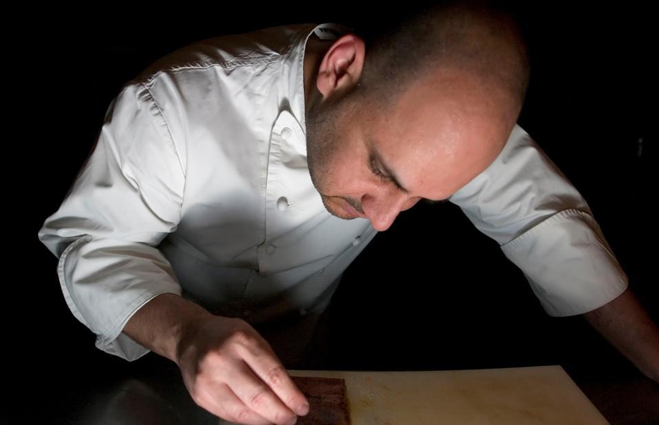 Chef Jordi Artal concentrating on his work at Cinc Sentits restaurant.