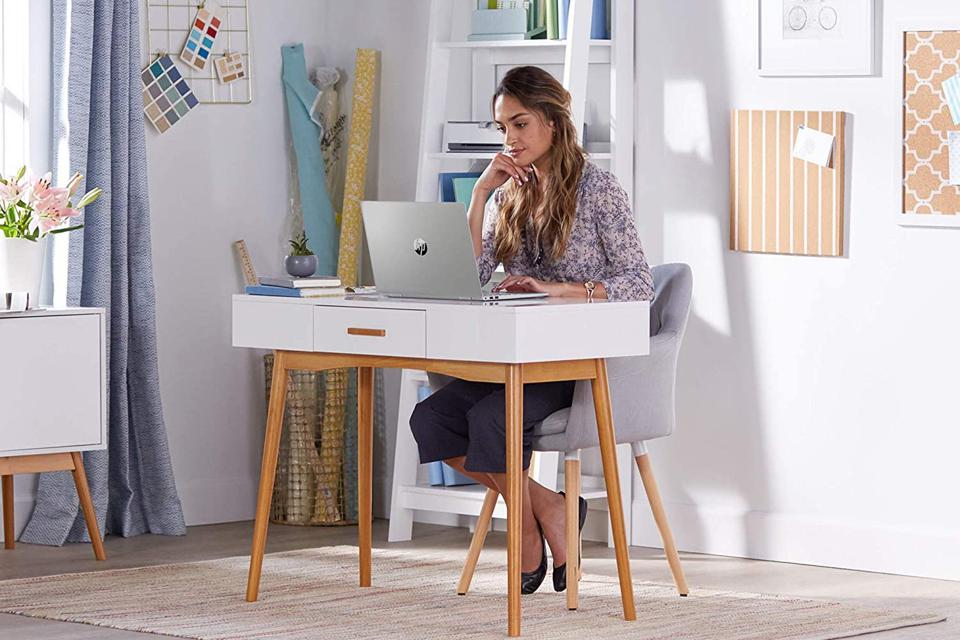 Young yoman using HP laptop computer at a desk