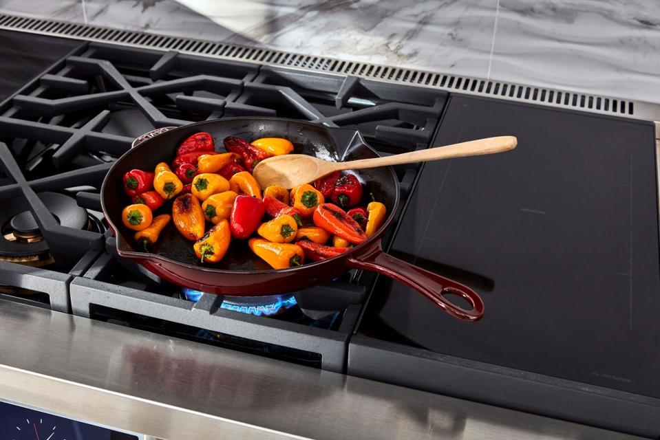 Vegetables in pan on gas cooktop