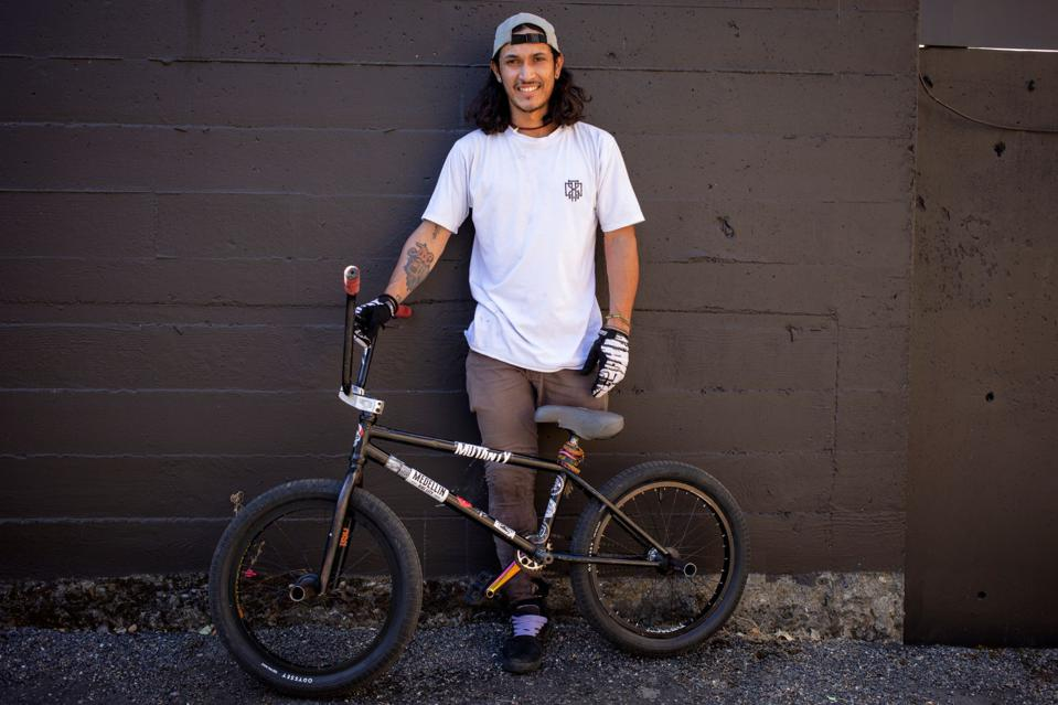 Julian Molina, 21, poses for a portrait with his bike during filming for X Games Real BMX
