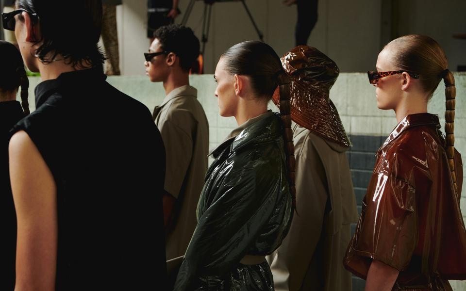 Models wait dressed up for the filming of Rains' Never Lost SS21 collection fashion film.