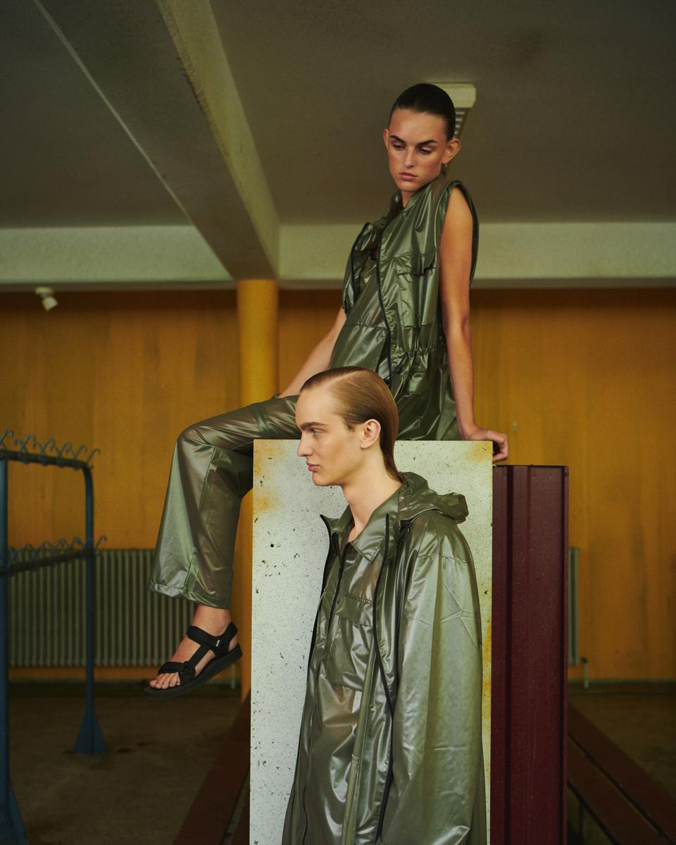 Models on set dressed in Rains SS21 collection.