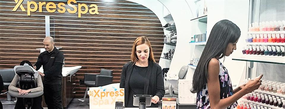 XpresSpa store showing massage and product selection