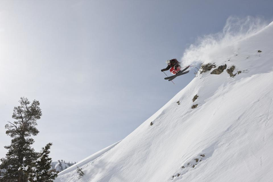 A skier jumping off a ledge