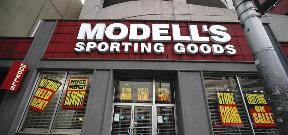 A Modell's Sporting Goods store in Manhattan with going out of business signs.