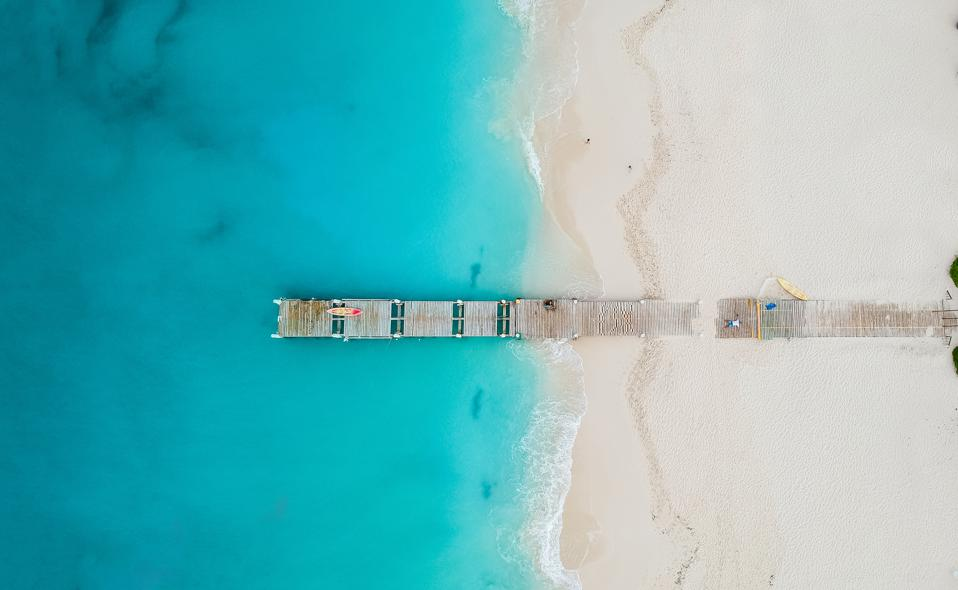 Drone panorama of pier in beach in Grace Bay, Providenciales, Turks and Caicos