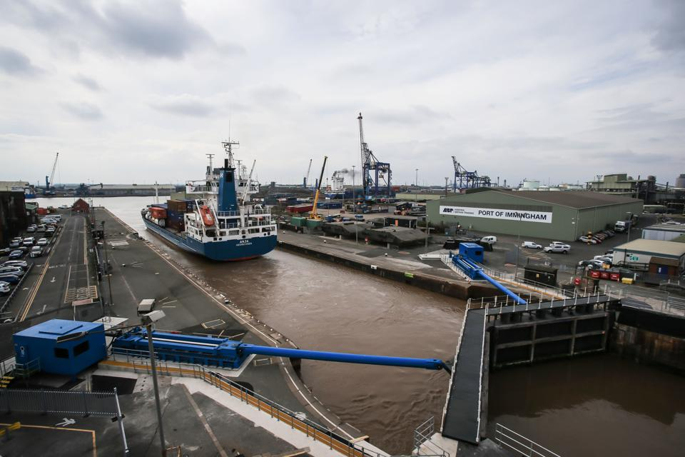 A ship leaves the Port of Immingham on the south bank of the Humber River in England.