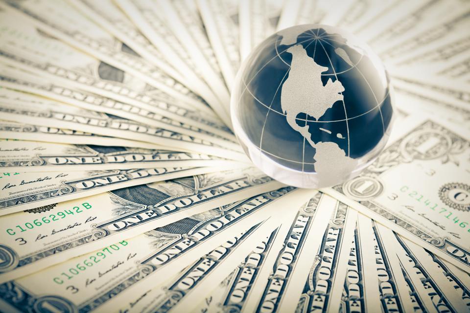 glass globe and money