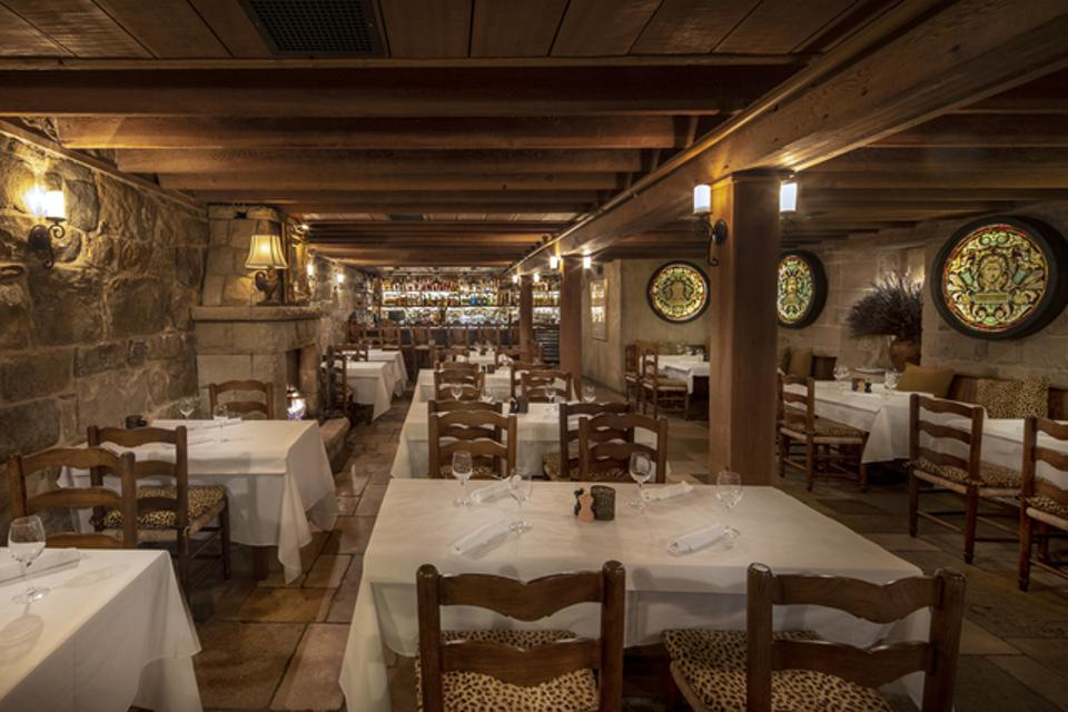 The dining room gives off an intimate and warm vibe perfect for a night with your special someone or a double-date.