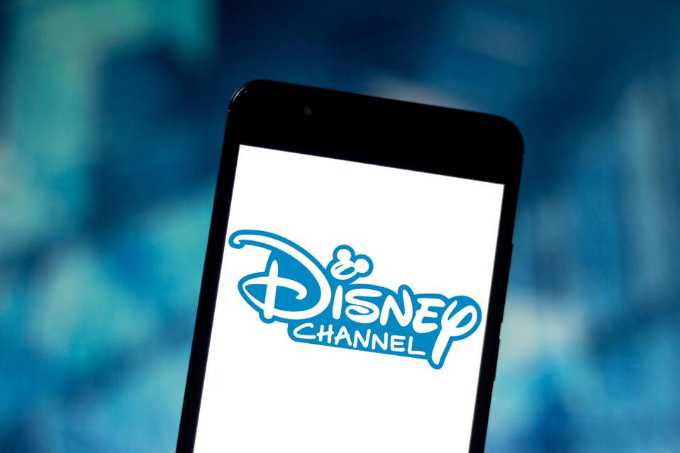 In this photo illustration the Disney Channel logo is seen...