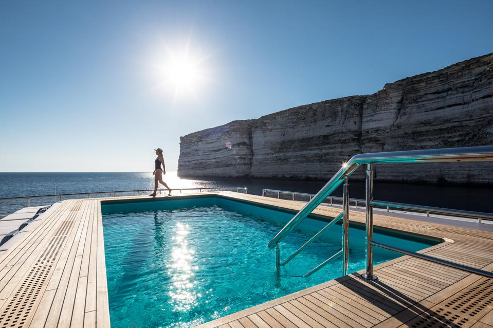 The the 351-foot-long superyacht LANA has a distinctive pool high on the main deck.