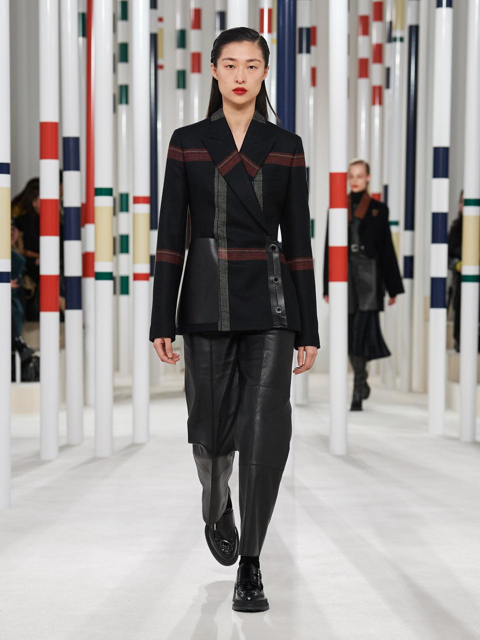 Hermès: Black check wool double-breasted jacket paired with black high waist trousers and black derby shoes.