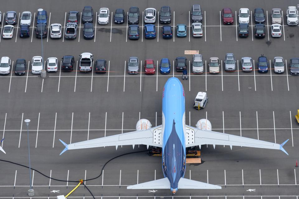 A Boeing 737 Max sits in a Boeing employees parking lot in Seattle.
