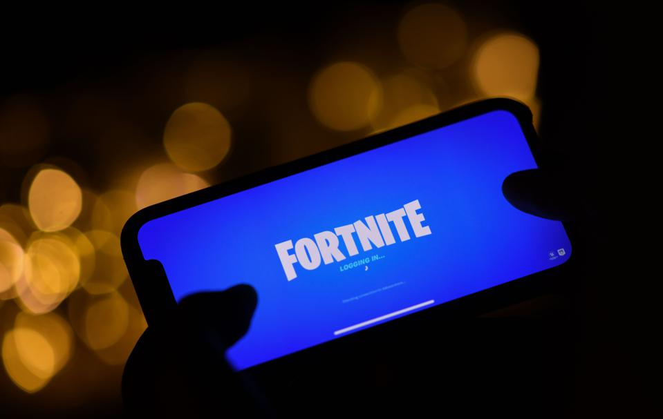 Smartphone with Fortnite loading screen