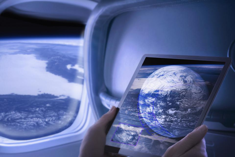 Woman views screen data on passenger space flight