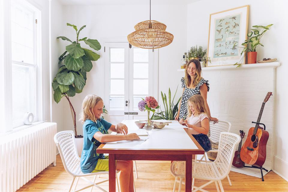 Children at a dining table with a rattan light fixture.