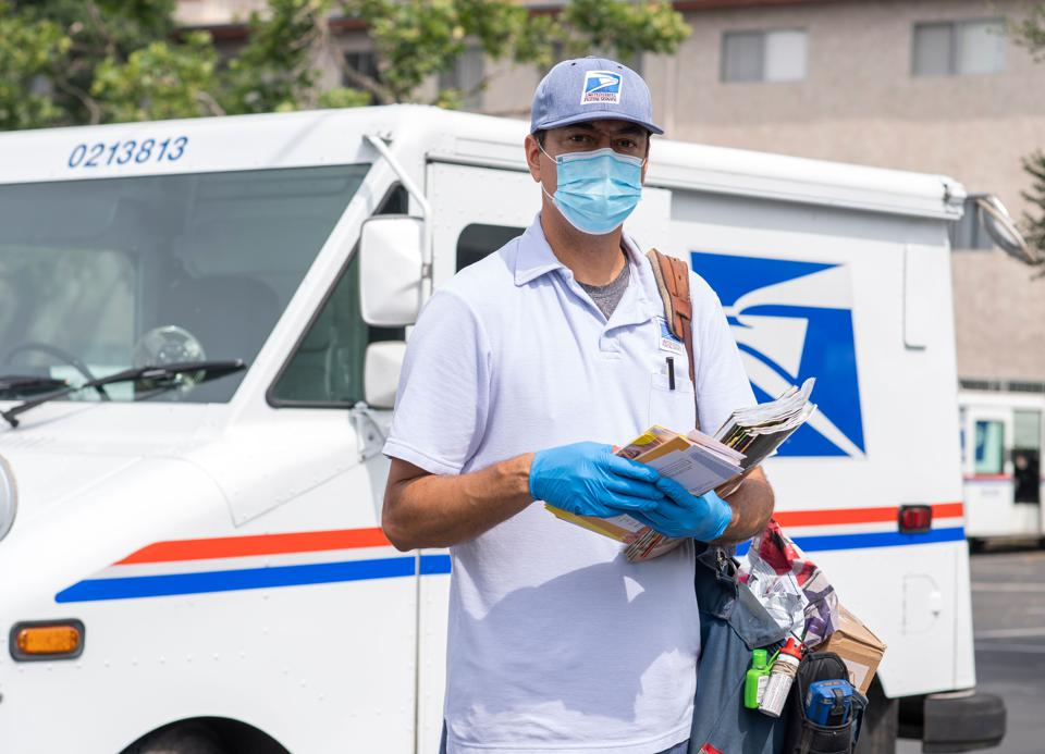 A mail carrier on his delivery route in Los Feliz amid the Covid 19 pandemic