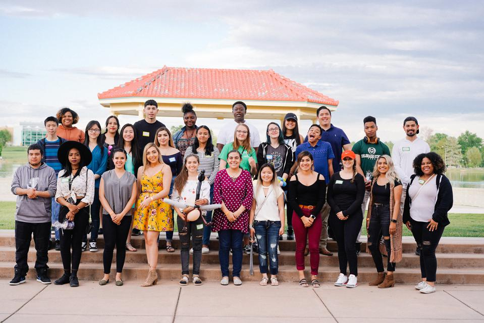 diverse group of 27 Denver Scholars posing for a picture in front of a gazebo in the daytime