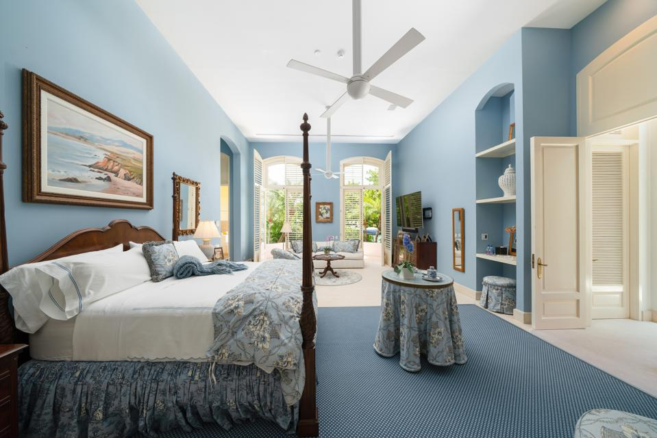 Master bedroom with ceiling fan and French doors
