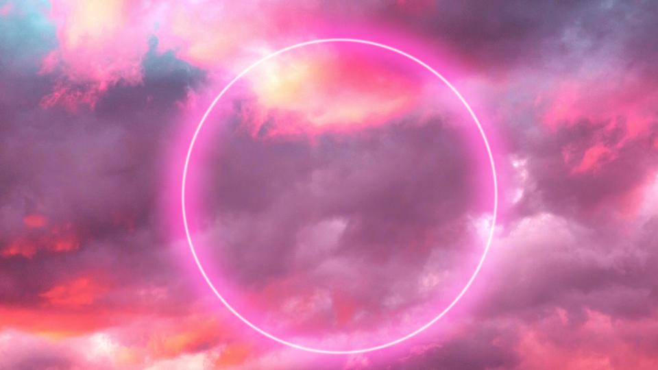 Futuristic neon circle in the burning sky with stunning pink colors.