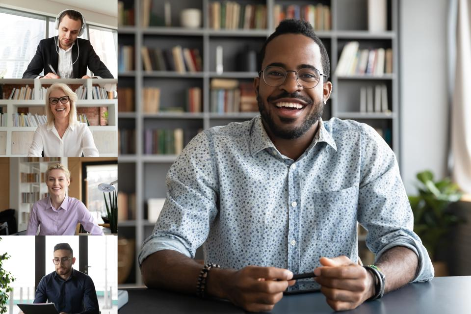 Diverse team uses video conference call service and computers to work remotely