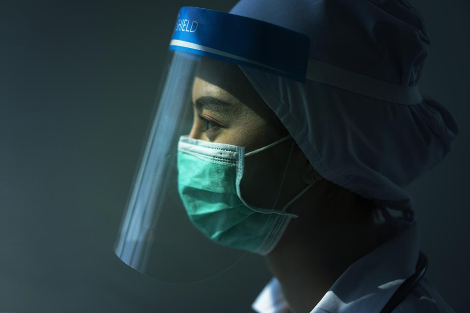 doctor in PPE suit uniform has stress in Coronavirus outbreak  and Emotional stress of overworked doctor and medical care team during covid-10 period.