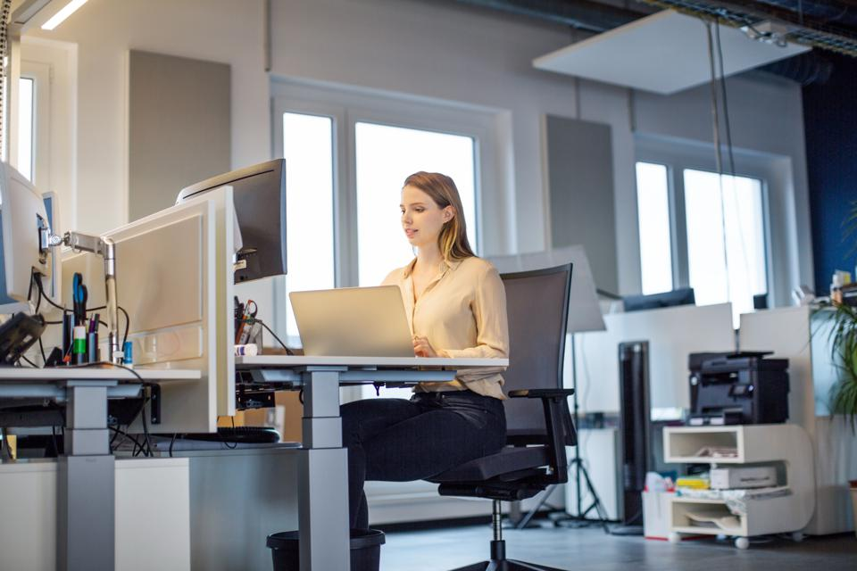 Female professional working in new modern office
