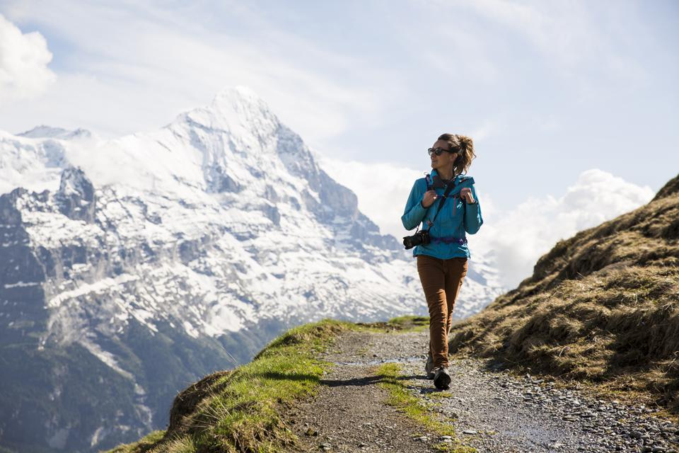 A woman hiking in the Swiss Alps