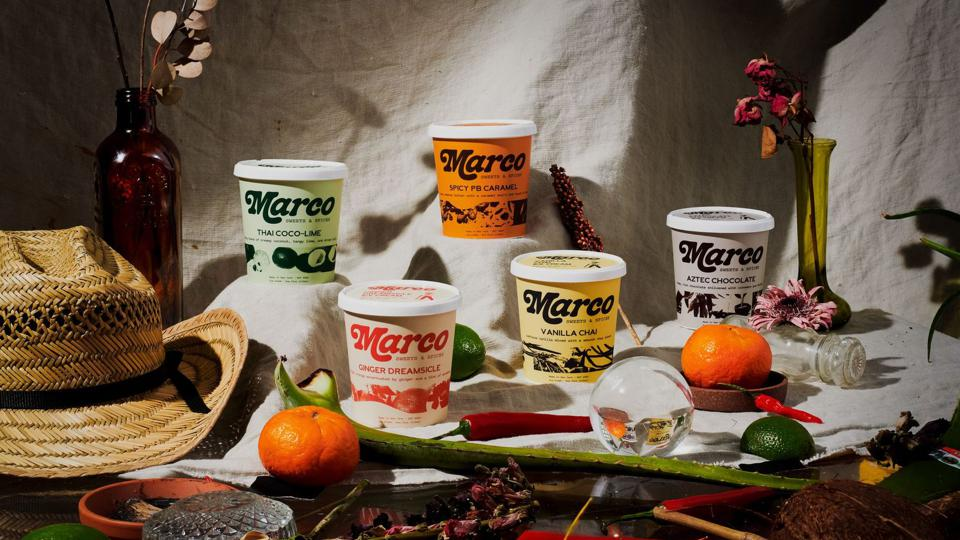 Five pints of the five different Marco Sweets & Spices flavors on a style backdrop