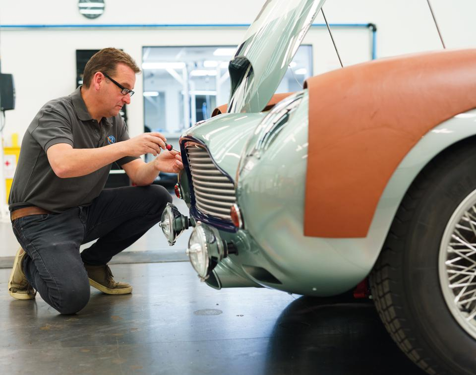 Engineer at R-Reforged working on an Aston Martin DB4 GT Continuation car