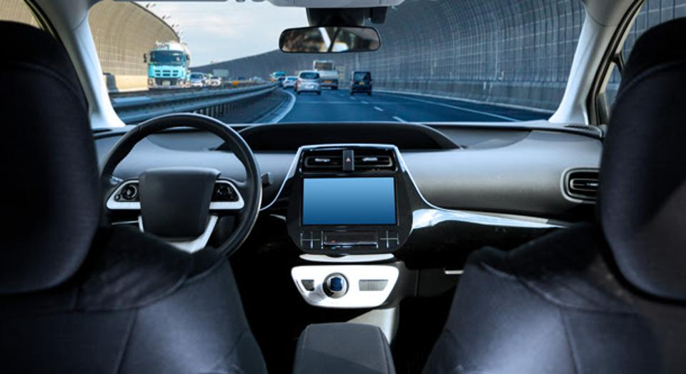 Interior, dashboard of car that is automated.