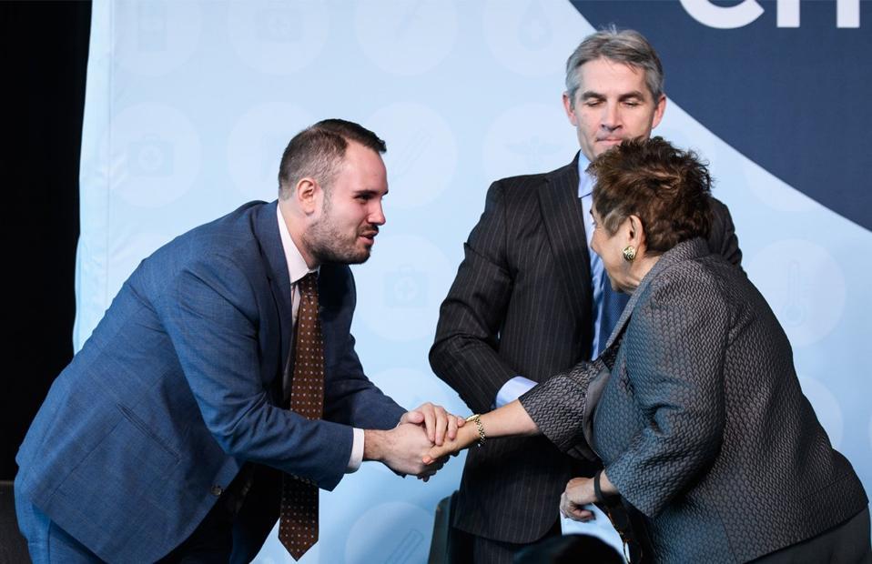 Jason Resendez shaking hands with Rep. Donna Shalala (D-Fla.)