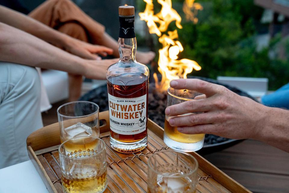 Cutwater whiskey with glasses