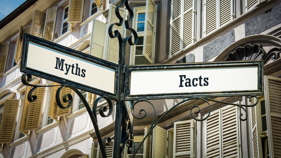Street sign that shows facts versus myths.