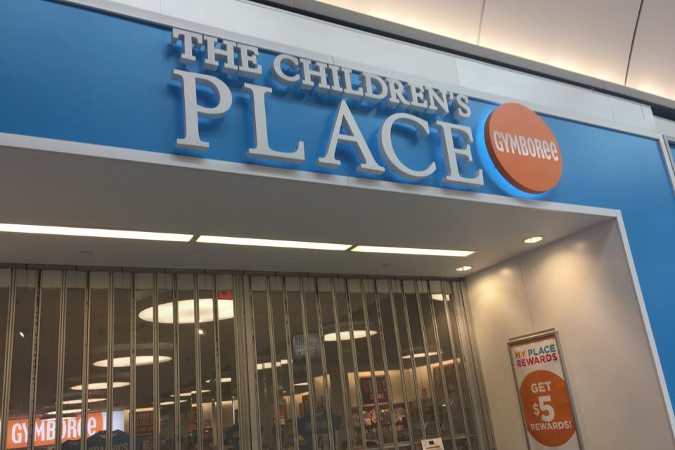 The outside of a Children's Place store that was closed in March due to the pandemic.