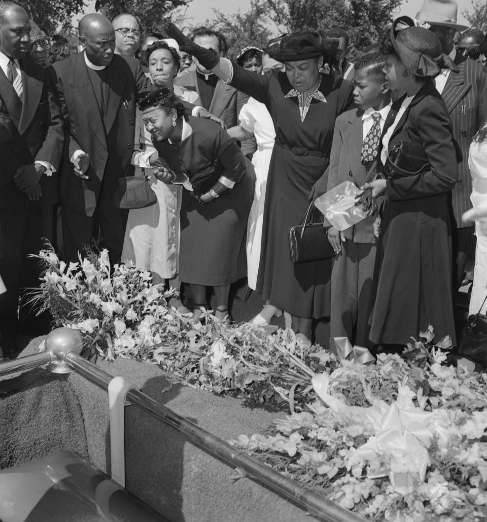 Mrs. Mamie Bradley Watches as Her Son is Lowered into the Ground