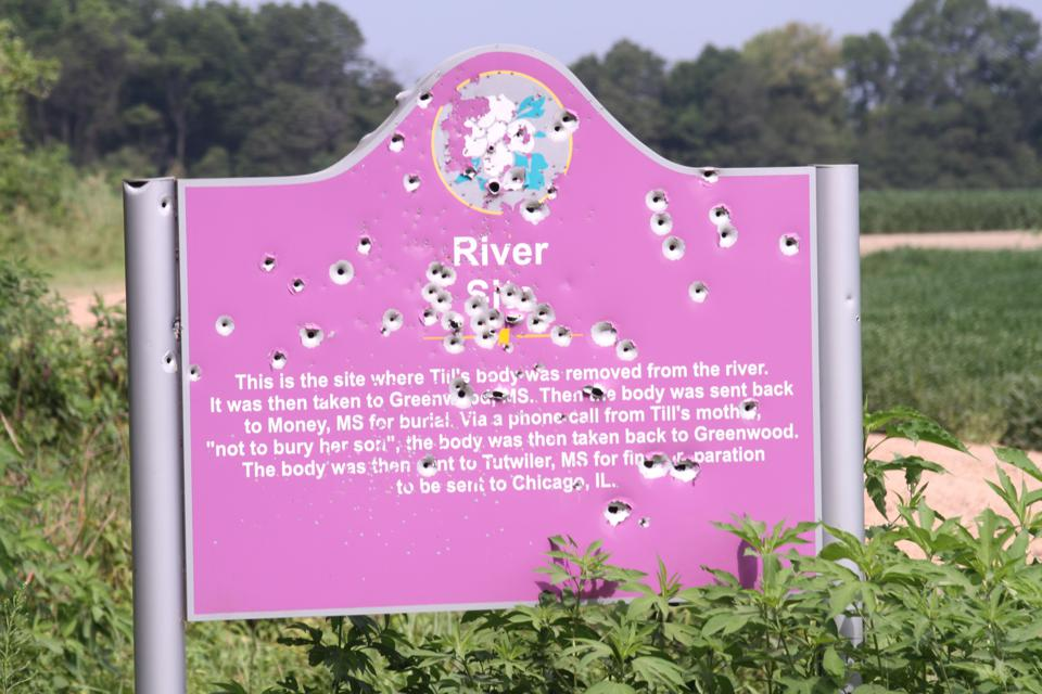 A vandalized sign at one of the Emmett Till memorial sites.
