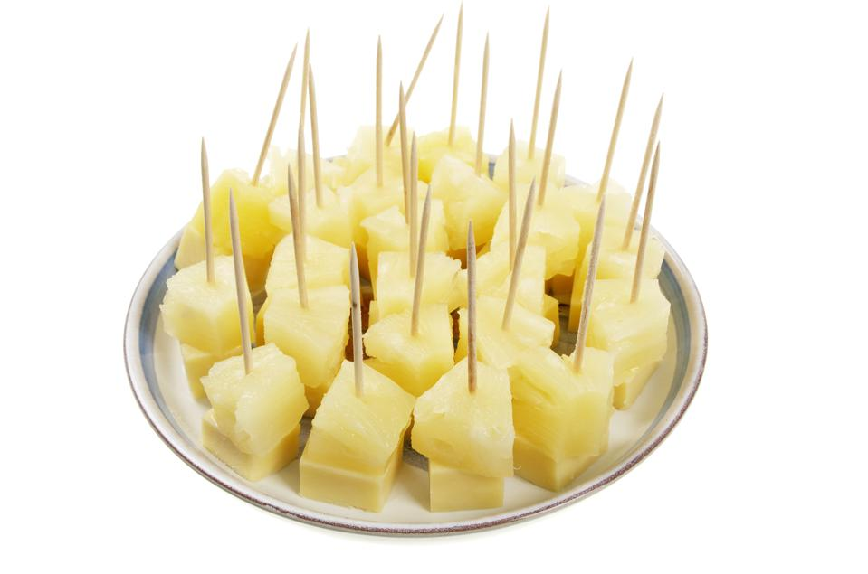 Plate Of Cheese And Pineapple On Cocktails Sticks